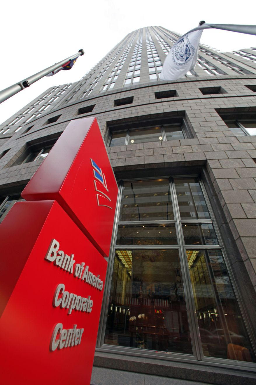 Bank of America's corporate headquarters in Charlotte, N.C. Bank of America reported a loss of $1.6 billion in the fourth quarter of 2010 after its costs related to soured home loans increased. (AP Photo/Chuck Burton)