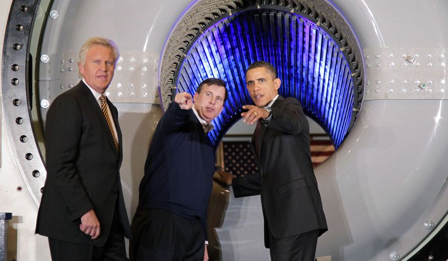 President Obama, accompanied by GE CEO Jeffrey Immelt, left, and Plant Manager Kevin Sharkey gestures while touring a GE plant in Schenectady, N.Y., Friday, Jan. 21, 2011. (AP Photo/J. Scott Applewhite)