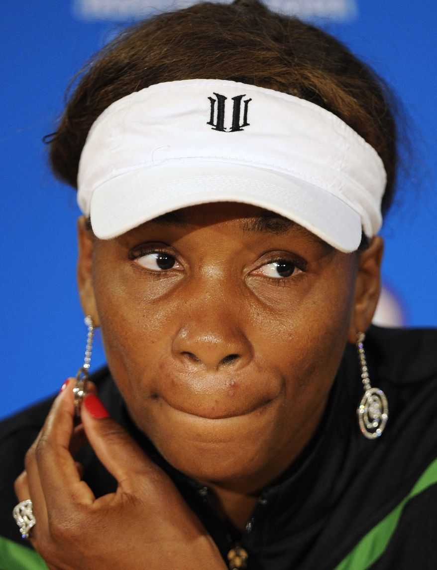 Venus Williams of the U.S. reacts during a press conference after she withdrew from her third round match against Germany's Andrea Petkovic injured at the Australian Open tennis championships in Melbourne, Australia, on Friday, Jan. 21, 2011. (AP Photo/Andrew Brownbill)
