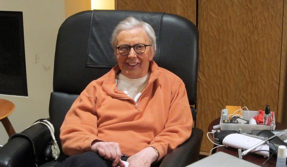 """This January 2011 photo provided by Roger Ebert shows the film critic wearing a silicone prosthesis over his lower face and neck. Ebert said in his Jan. 19 blog that he will wear the prosthesis for the """"Roger's Office"""" segment of the new television show """"Ebert Presents at the Movies."""" (AP Photo/Ebert Productions, David Rotter)"""