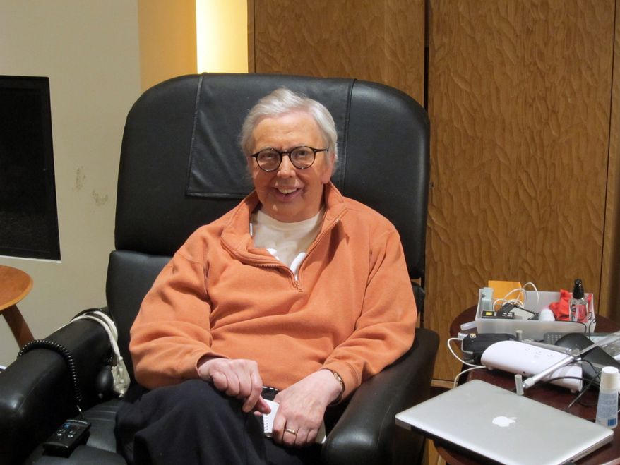 "This January 2011 photo provided by Roger Ebert shows the film critic wearing a silicone prosthesis over his lower face and neck. Ebert said in his Jan. 19 blog that he will wear the prosthesis for the ""Roger's Office"" segment of the new television show ""Ebert Presents at the Movies."" (AP Photo/Ebert Productions, David Rotter)"