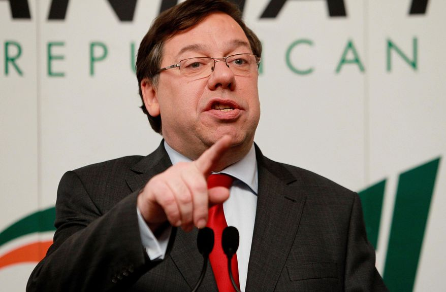 Ireland's Prime Minister Brian Cowen, left, announces his resignation as leader of Ireland's dominant Fianna Fail party on Saturday, Jan, 22, 2011, in Dublin. Cowen announced Saturday that he has resigned as leader of Ireland's dominant Fianna Fail party but intends to keep leading the government through the March 11 election. Opposition chiefs demanded his immediate ouster as premier. (AP Photo/Julien Behal/PA Wire)