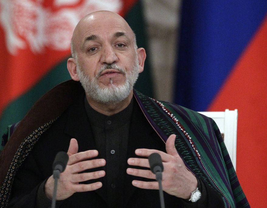 ** FILE ** Afghanistan President Hamid Karzai gestures during a joint press conference in Moscow's Kremlin, Russia, Friday, Jan. 21, 2011. (AP Photo/Alexander Zemlianichenko)
