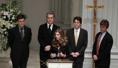 Maria Shriver, center, speaks as her brothers Tim Shriver, Bobby Shriver, Mark Shriver, Anthony Shriver stand behind her during the wake for their father R. Sargent Shriver at Holy Trinity Catholic Church in Washington on Friday, Jan. 21, 2011. Shriver, an in-law of the Kennedy's, and the first director of the Peace Corps, died Tuesday, he was 95. (AP Photo/Alex Brandon, Pool)