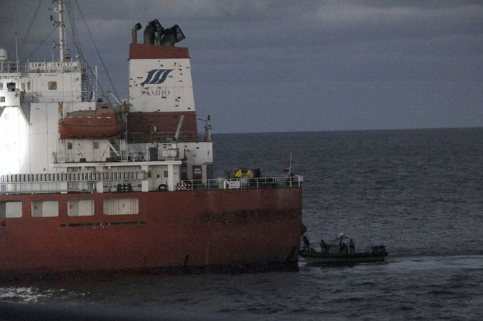 In this photo released by the South Korean navy via the Yonhap news agency, South Korean naval special forces approach the South Korean cargo ship Samho Jewelry in a military operation in the Arabian Sea on Friday, Jan. 21, 2011. In a daring raid, the special forces stormed the hijacked freighter