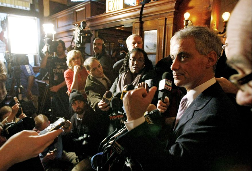 Rahm Emanuel speaks in Chicago on Monday after an Illinois appeals court threw him off the ballot for Chicago mayor because he didn't live in the city in the year before the election. The court voted 2-1 to overturn a lower-court ruling that would have kept Mr. Emanuel's name on the ballot. (Associated Press)