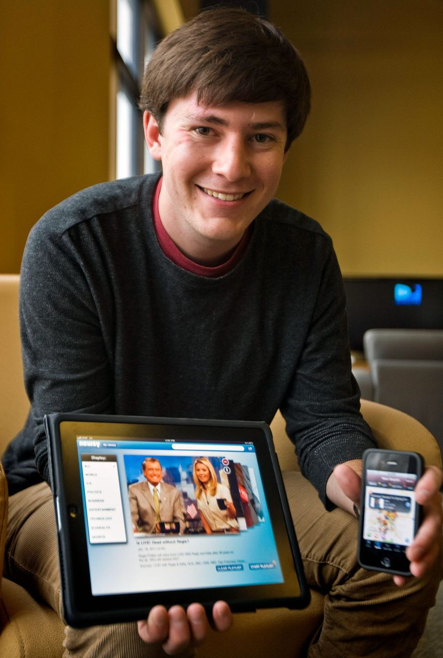 Tony Brown at the University of Missouri shows off applications he helped develop. Students who create something may face the burden of proving their work in no way benefited from the student being in college. (Associated Press)