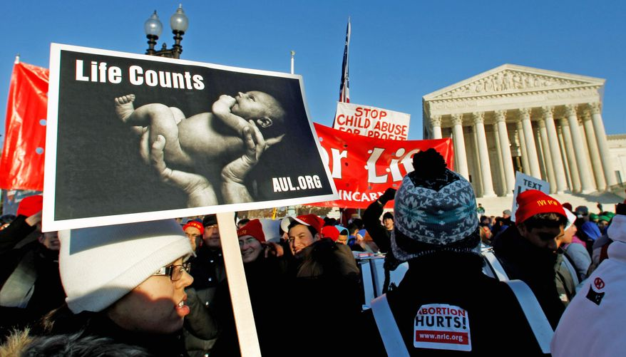"""**FILE** Abortion foes gather Jan. 24 in front of the U.S. Supreme Court for a rally against the Roe v. Wade decision 38 years ago that legalized abortion. An estimated three dozen members of Congress spoke to the """"March for Life"""" crowd. (Associated Press)"""