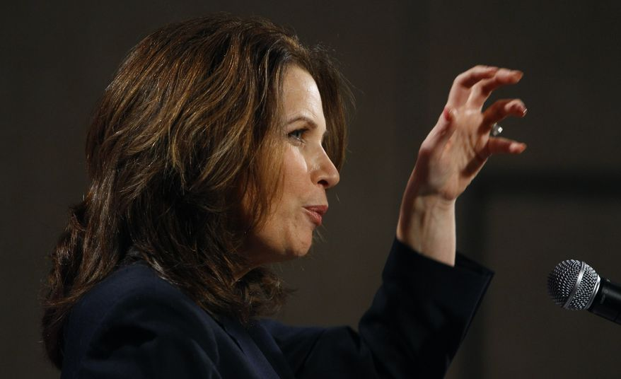 Rep. Michele Bachmann, Minnesota Republican, speaks Friday at a reception by the Iowans for Tax Relief in Des Moines, Iowa. (Associated Press)