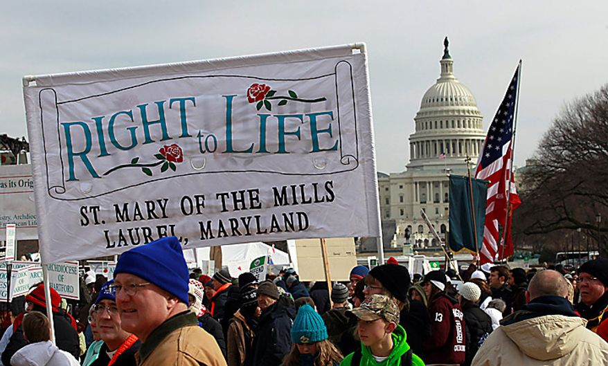 The crowd gathers at the start of an anti-abortion rally on the National Mall in Washington on Monday, Jan. 24, 2011. The anniversary of the Supreme Court's Roe v. Wade decision was Saturday.  (AP Photo/Alex Brandon)