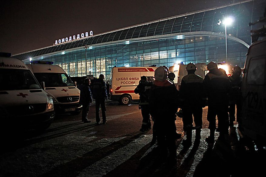 Ambulance vehicles and emergency workers are seen in front of Domodedovo Airport in Moscow, Monday, Jan. 24, 2011. An explosion ripped through the international arrivals hall at Moscow's busiest airport on Monday, killing dozens of people and wounding scores, officials said. Russian President Dmitry Medvedev called it a terror attack. (AP Photo/Alexander Zemlianichenko)