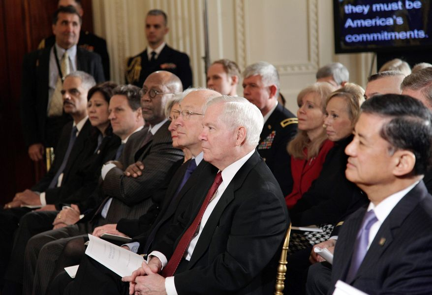 Defense Secretary Robert M. Gates (center) listens as President Obama announces initiatives to support military families Monday. From right are: Veterans Affairs Secretary Eric Shinseki, Mr. Gates, Interior Secretary Ken Salazar, Health and Human Services Secretary Kathleen Sebelius, U.S. Trade Representative Ron Kirk, Treasury Secretary Timothy F. Geithner, Labor Secretary Hilda L. Solis and Attorney General Eric H. Holder Jr. (Associated Press)