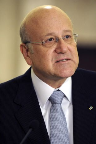 Lebanese Prime Minister designate Najib Mikati speaks during a press conference at the presidential palace in Baabda, east of Beirut, Lebanon, Tuesday, Jan. 25, 2011. (AP Photo/Assaad Ahmad)