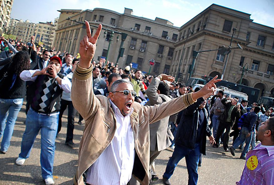 Anti-government protesters demonstrate in downtown Cairo, Egypt, Tuesday, Jan. 25, 2011. Hundreds of anti-government protesters marched in the Egyptian capital chanting against President Hosni Mubarak and calling for an end to poverty. (AP Photo/Mohammed Abu Zaid)