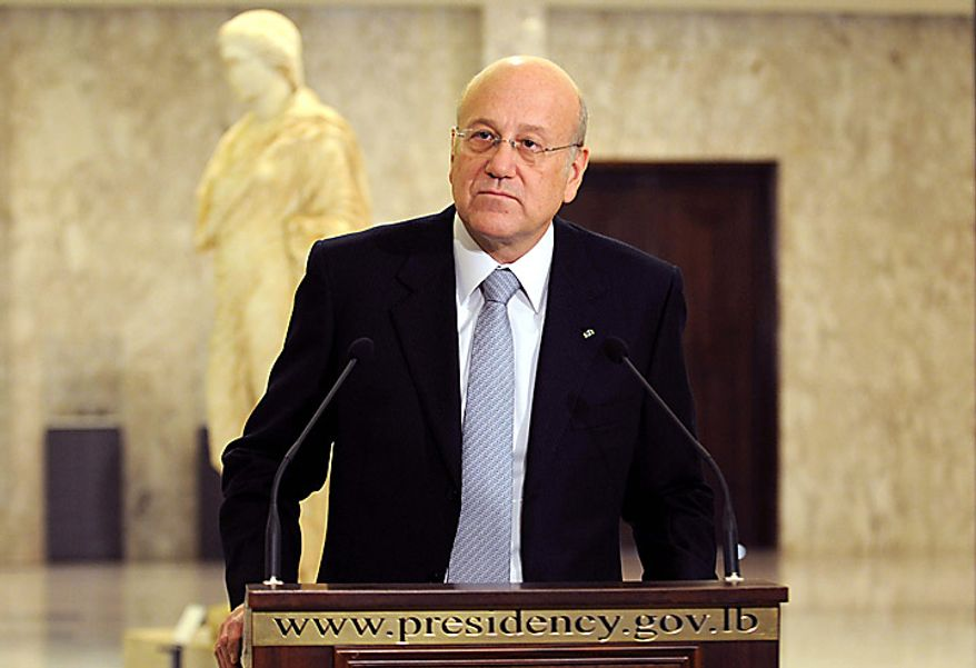 Lebanese Prime Minister designate Najib Mikati speaks during a press conference at the presidential palace in Baabda, east of Beirut, Lebanon, Tuesday, Jan. 25, 2011. Lebanon's president has formally appointed the Hezbollah-backed candidate as prime minister-designate and asked him to form a new government. Mr. Mikati, billionaire businessman and former premier, won a majority of parliament support in two days of voting that ended Tuesday. (AP Photo/Assaad Ahmad)