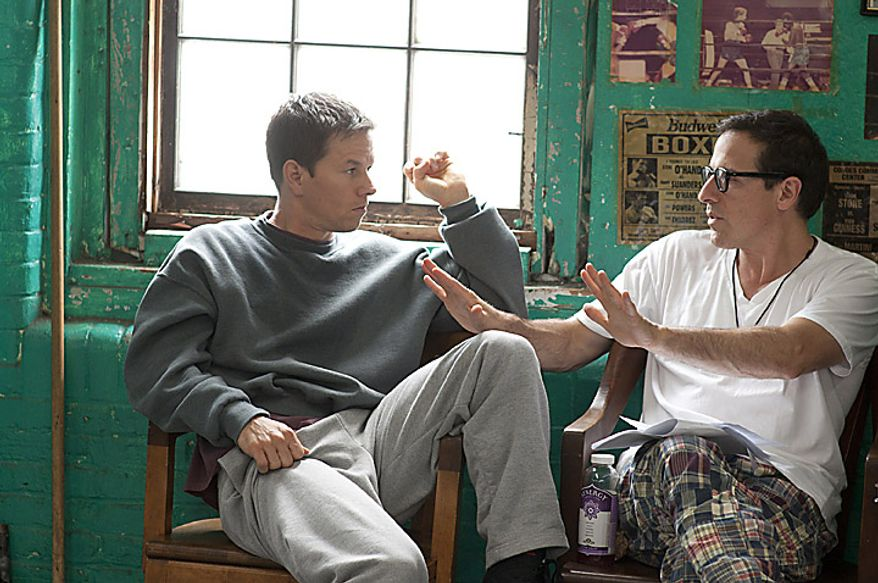 """In this publicity image released by Paramount Pictures, Mark Wahlberg, left, and director David O. Russell are shown on the set of """"The Fighter.""""  Mr. Russell was nominated for an Academy Award for best director for """"The Fighter."""" (AP Photo/Paramount Pictures, Jojo Whilden)"""