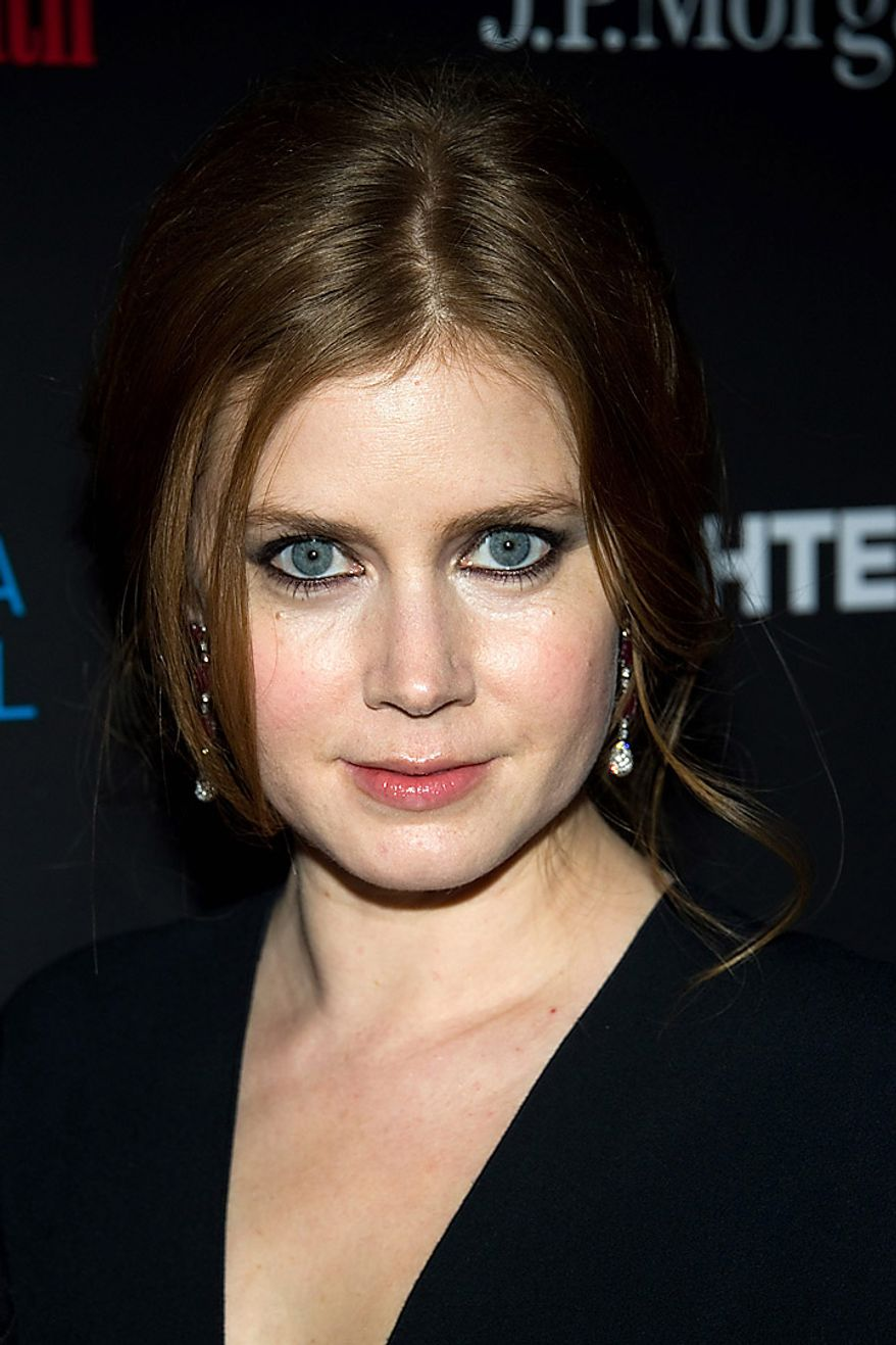 "In this Dec. 10, 2010, file photo, Amy Adams attends a screening of 'The Fighter' hosted by the Cinema Society in New York. Ms. Adams was nominated for an Academy Award for best supporting actress for her role in ""The Fighter,""  Tuesday, Jan. 25, 2011. The Oscars will be presented Feb. 27 at the Kodak Theatre in Hollywood. (AP Photo/Charles Sykes, file)"