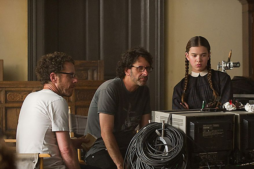 """Directors Ethan Coen, left, Joel Coen, and actress Hailee Steinfeld during the filming of """"True Grit."""" The Coen brothers were nominated for an Academy Award for best director for """"True Grit,"""" Tuesday, Jan. 25, 2011. The Oscars will be presented Feb. 27 at the Kodak Theatre in Hollywood. (AP Photo/Paramount Pictures, Wilson Webb)"""