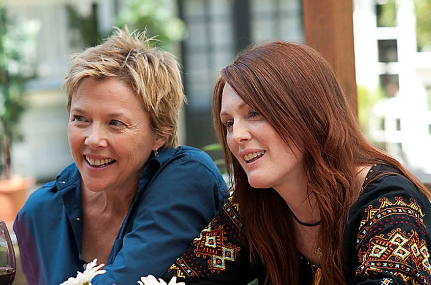 "Annette Bening, left, and Julianne Moore in a scene from ""The Kids are All Right."" The film was nominated for an Academy Award for best film, Tuesday, Jan. 25, 2011. The Oscars will be presented Feb. 27 at the Kodak Theatre in Hollywood. (AP Photo/Focus Features, Suzanne Tenner)"