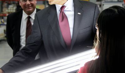 The president tours Orion Energy Systems, which makes high-efficiency lighting and renewable solar technology for businesses, in Manitowoc, Wis., on Wednesday. He is joined by Orion founder and CEO Neal Verfuerth. (Associated Press)