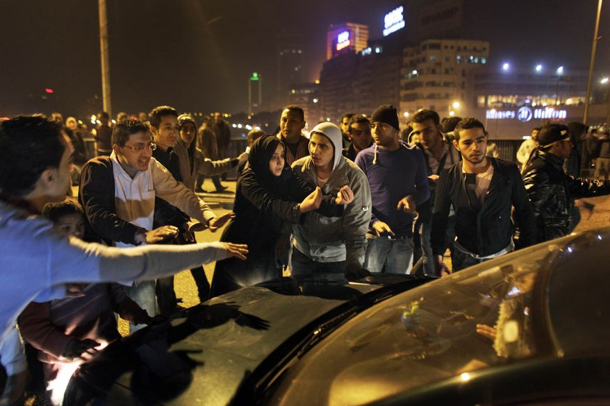 Protesters stop traffic in the middle of a bridge over the Nile river during clashes in downtown Cairo, Egypt, in the early hours of Wednesday, Jan. 26, 2011. Egyptian police fired tear gas and rubber bullets and beat protesters to clear thousands of people from a central Cairo square Wednesday after the biggest demonstrations in years against President Hosni Mubarak's authoritarian rule. (AP Photo/Ben Curtis)