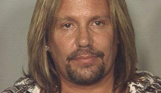 ** FILE ** This June 28, 2010, file photo released by the Las Vegas Metropolitan Police Department, shows Motley Crue singer Vince Neil, who is heading to court on Wednesday, Jan. 26, 2011, for a plea deal that gets him two weeks of jail time, plus two weeks of house arrest, for driving drunk last summer near the Las Vegas Strip. (AP Photo/Las Vegas Metropolitan Police Department, File)