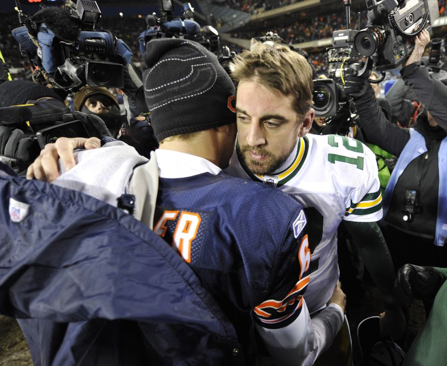 Green Bay Packers quarterback Aaron Rodgers (12) and Chicago Bears quarterback Jay Cutler greet each on the field after the Packers' 21-14 win over the Bears in the NFC Championship NFL football game Sunday, Jan. 23, 2011, in Chicago. (AP Photo/Jim Prisching)