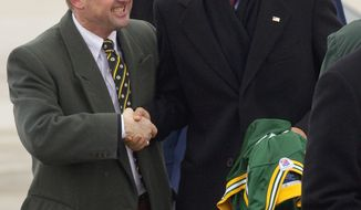 President Obama shakes hand with Green Bay, Wis., Mayor Jim Schmitt upon arriving in Green Bay, Wis. Wednesday, Jan. 26. 2011, before departing for Manitowoc, Wis., as part of his White House to Main Street Tour. Mr. Schmidt gave the president a Green Bay Packers jersey. (AP Photo/Mike Roemer)