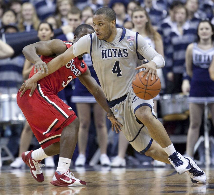 St. John's guard Malik Boothe, left, guards Georgetown guard Chris Wright (4) during the first half of an NCAA college basketball game Wednesday, Jan. 26, 2011, in Washington. Wright recently attended his second pre-draft workout with the Washington Wizards. The NBA draft is Thursday. (AP Photo/Evan Vucci)