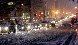 Vehicles clog the downtown streets of Washington as traffic comes to a halt as snow begins to fall, Wednesday, Jan. 26, 2011. (AP Photo/Pablo Monsivais)