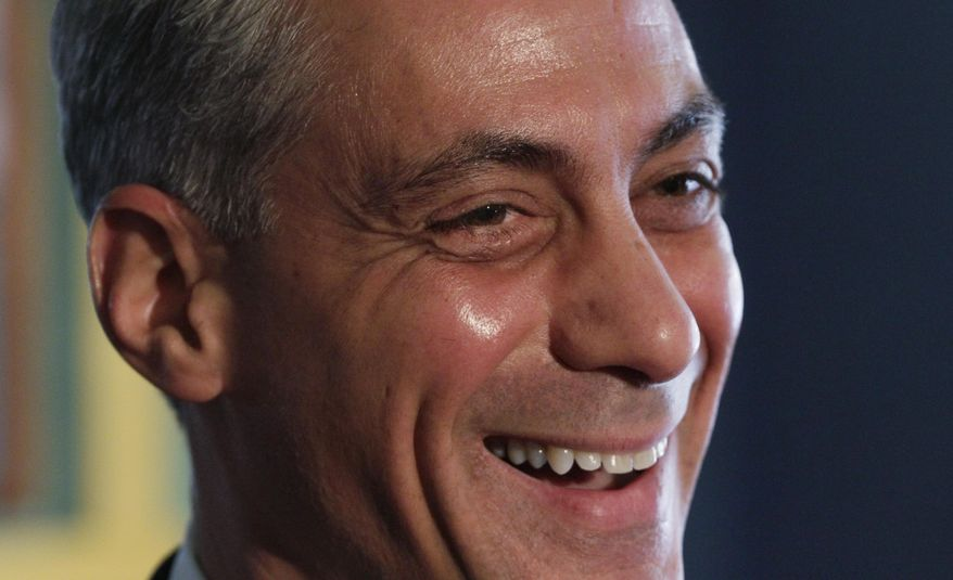 Former White House Chief of Staff Rahm Emanuel smiles Thursday at Wishbone Restaurant in Chicago after being endorsed by Rep. Mike Quigley. (Associated Press)