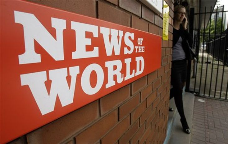 **FILE** This photo from July 9, 2009, shows a sign for the News of the World newspaper outside the offices of its owner News International Ltd., in London. (Associated Press)