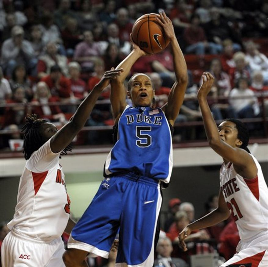 Duke's Krystal Thomas (34) reacts to her basket against North Carolina State during the second half an NCAA college basketball game in Raleigh, N.C., Sunday, Jan. 23, 2011. Duke won 65-64. (AP Photo/Sara D. Davis)
