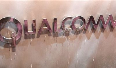 FILE - In this file photo made Jan. 9, 2010, the Qualcomm logo is seen at an exhibit at the Consumer Electronics Show in Las Vegas. Qualcomm Inc., releases quarterly financial earnings Wednesday, Jan. 26, 2011, after the market close. (AP Photo/Paul Sakuma, file)
