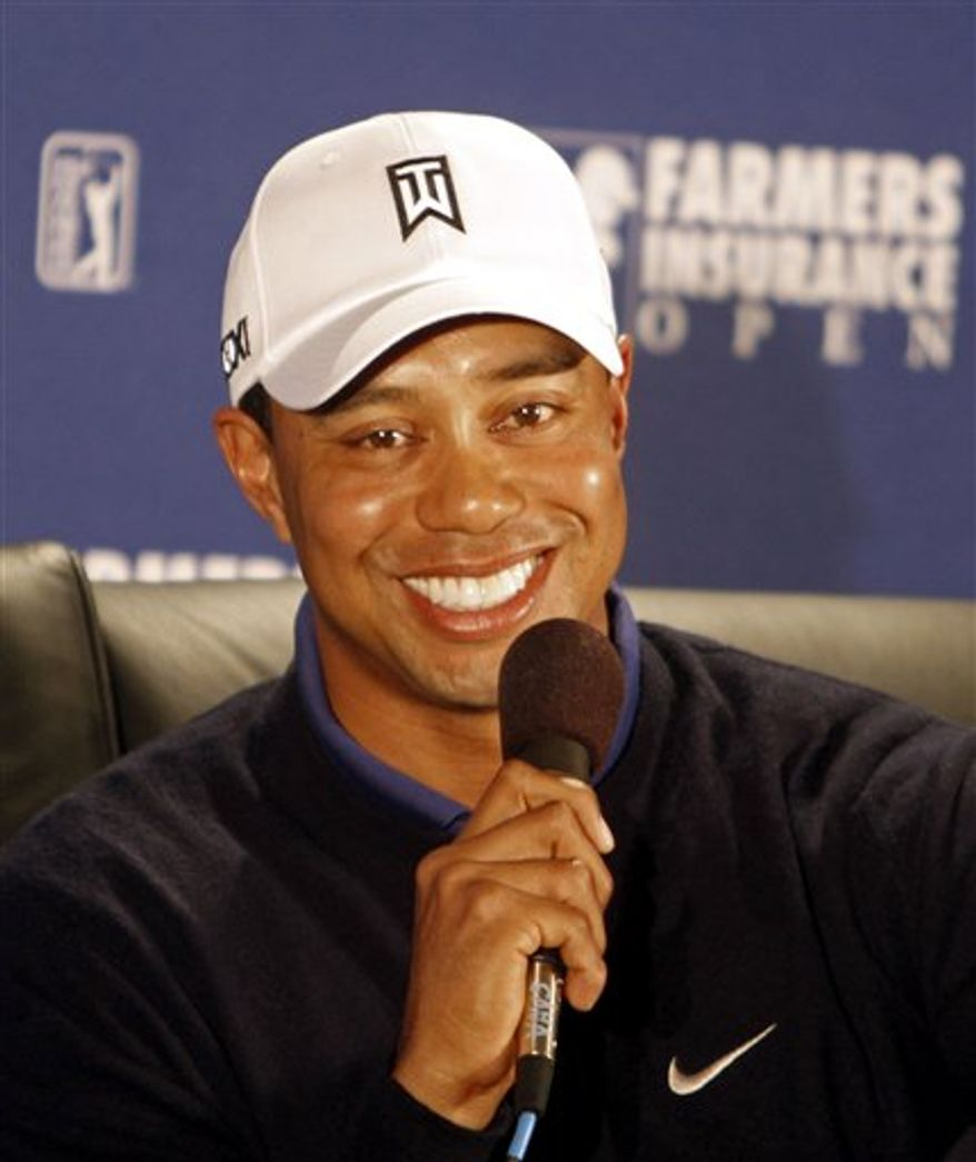 Tiger Woods listens to a question during a news conference at the Farmers Insurance Open golf tournament in San Diego, Wednesday, Jan. 26, 2011. (AP Photo/Lenny Ignelzi)