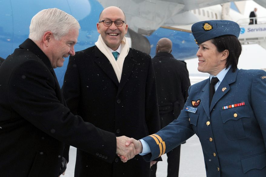 Defense Secretary Robert M. Gates, left, shakes hands with Canadian Capt. Nancy Silver, while U.S. Ambassador to Canada David Jacobson looks on, upon his arrival in Ottawa, Canada, Wednesday, Jan. 26, 2010. Gates is in Canada to attend trilateral meetings with his counterparts from Canada and Mexico. (AP Photo/Dept. of Defense, Cherie Cullen)