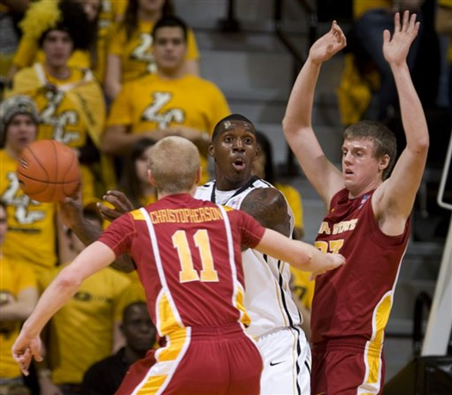 Missouri's Ricardo Ratliffe, center, looks to pass the ball as he is surrounded by Iowa State's Jamie Vanderbeken, right, and Scott Christopherson, left, during the first half of an NCAA college basketball game ,Saturday, Jan. 22, 2011, in Columbia. Mo. (AP Photo/L.G. Patterson)