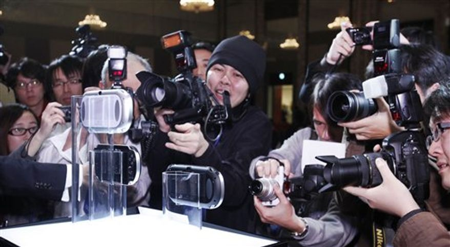 """The new PlayStation Portable """"NGP"""" is displayed at PlayStation Meeting 2011 in Tokyo Thursday, Jan. 27, 2011. Sony says an upgraded version of its PlayStation Portable machine will go on sale late this year. (AP Photo/Shizuo Kambayashi)"""