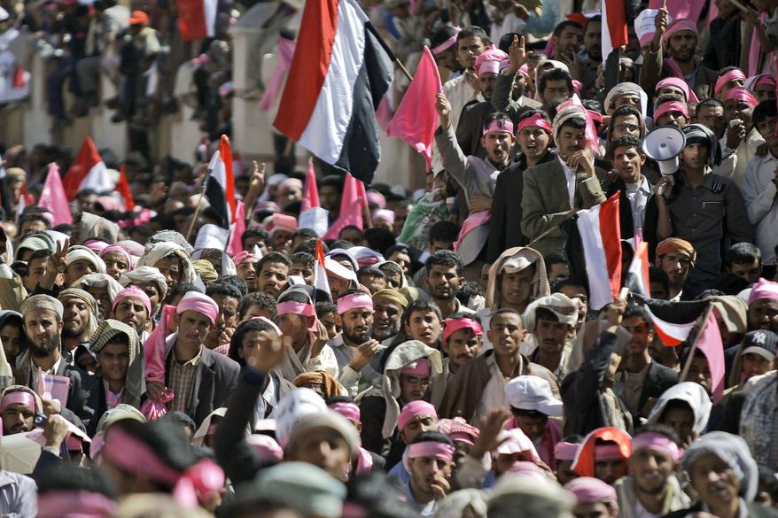 Yemeni demonstrators hold their national flags during a rally calling for an end to the government of President Ali Abdullah Saleh, in Sanaa, Yemen, Thursday, Jan. 27, 2011. (AP Photo/Hani Mohammed)