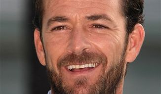 FILE - In this Oct. 5, 2010 file photo, U.S. actor Luke Perry poses for photographers during the 26th MIPCOM (International Film and Programme Market for Tv, Video,Cable and Satellitte) in Cannes, southeastern France. (AP Photo/Lionel Cironneau, file)