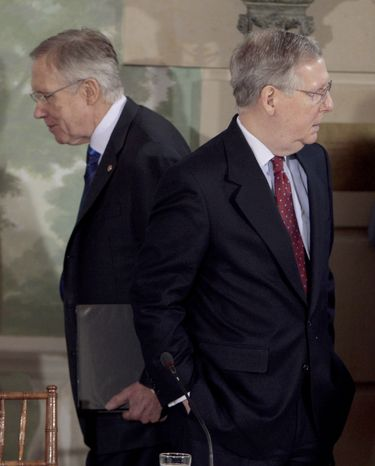 In this Feb. 25, 2010, file photo Senate Majority Leader Harry Reid of Nevada, left, walks past Senate Minority Leader Mitch McConnell of Kentucky, during a meeting at the Blair House in Washington. In a rare moment of agreement at the January 2011 start of the 112th Congress Mr. McConnell and Mr. Reid opened by endorsing a bipartisan effort to find ways to improve an unwieldy, unproductive process for naming and confirming the nation's top officials. (AP Photo/Pablo Martinez Monsivais, File)