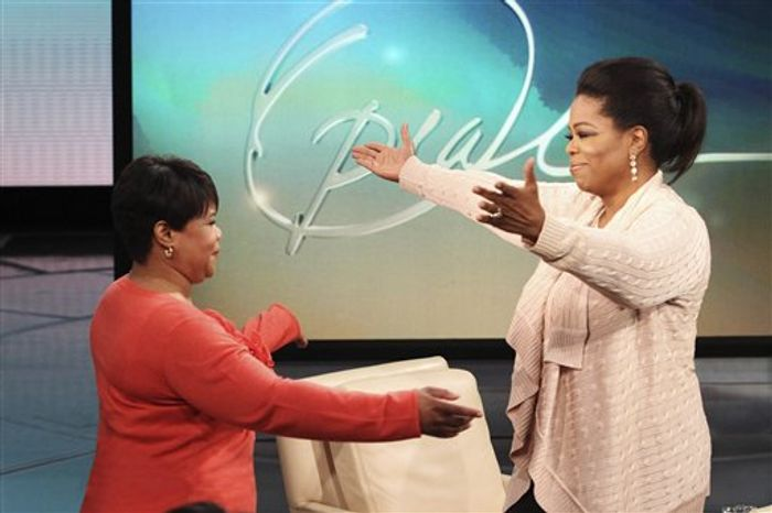 """This photo taken Jan. 19, 2011 and provided by Harpo Productions Inc., shows talk-show host Oprah Winfrey greeting her half-sister Patricia on an episode of """"The Oprah Winfrey Show"""" taped at Harpo Studios in Chicago. On the show that aired Monday, Jan. 24, 2011, a sometimes-emotional Winfrey introduced Patricia, explaining how the woman's years-long search for her family culminated in a meeting with Winfrey on Thanksgiving Day of last year. (AP Photo/Harpo Productions Inc., George Burns)  NO SALES"""