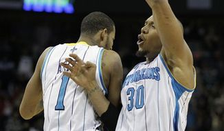 New Orleans Hornets forward David West (30) hits the game-winning shot over Oklahoma City Thunder forward Serge Ibaka (9) in an NBA basketball game in New Orleans, Monday, Jan. 24, 2011. The Hornets defeated the Thunder 91-89. (AP Photo/Bill Haber)