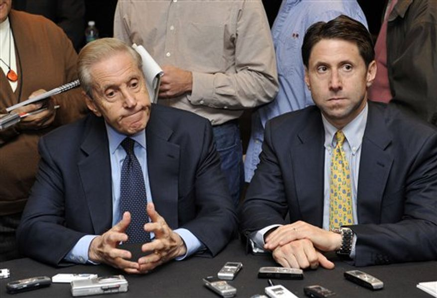 """FILE- In this Oct. 29, 2010, file photo, New York Mets owner Fred Wilpon, left, and COO Jeff Wilpon, listen to a question from the media during a baseball news conference in New York. The Mets are exploring a partial sale of the team as they face a lawsuit from a trustee trying to reclaim money for victims of the Bernard Madoff swindle. The owners, Fred Wilpon and son Jeff, say they are looking into the sale to """"address the air of uncertainty created by this lawsuit.""""  (AP Photo/Kathy Kmonicek, File)"""