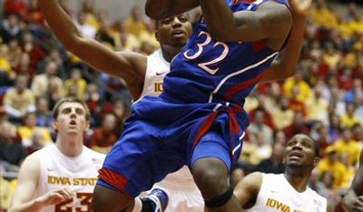 FILE - In this Jan. 12, 2011, file photo, Kansas guard Josh Selby (32) shoots over Iowa State forward Jamie Vanderbeken (23), forward Melvin Ejim and guard Jake Anderson (5) during the first half of an NCAA college basketball game in Ames, Iowa. (AP Photo/Charlie Neibergall, File0