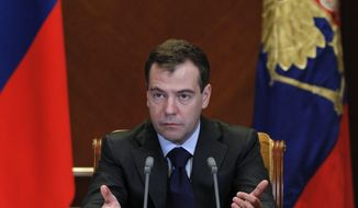 Russian President Dmitry Medvedev gestures as he heads a meeting on economic issues at the Gorki presidential residence outside Moscow on Friday, Jan. 28, 2011. (AP Photo/RIA Novosti, Dmitry Astakhov, Presidential Press Service)