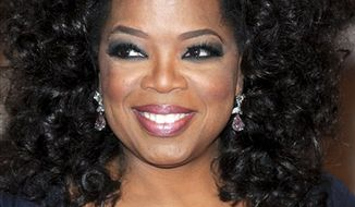 FILE - In this May 3, 2010 file photo, Oprah Winfrey arrives at the Metropolitan Museum of Art Costume Institute gala in New York.  The Oprah Winfrey Network has grown its prime-time audience by one-third over the network it replaced.   OWN's all-day viewership is up 25 percent over the year-ago audience for Discovery Health, whose channel OWN claimed when it signed on Jan. 1. (AP Photo/Evan Agostini, File)