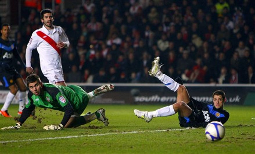 Arsenal's Marouane Chamakh reacts after a missed opportunity to score against Leyton Orient during their fifth round English FA Cup soccer match at the Brisbane Road stadium, London, Sunday, Feb. 20, 2011. (AP Photo/Tom Hevezi)   NO INTERNET/MOBILE USAGE WITHOUT FOOTBALL ASSOCIATION PREMIER LEAGUE(FAPL)LICENCE. CALL +44 (0) 20 7864 9121 or EMAIL info@football-dataco.com FOR DETAILS