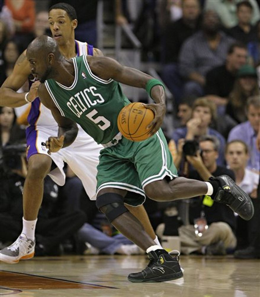 Boston Celtics' Shaquillle O'Neal (36) is fouled by Phoenix Suns' Marcin Gortat, of Poland, during the second quarter of an NBA basketball game Friday, Jan. 28, 2011, in Phoenix. (AP Photo/Matt York)
