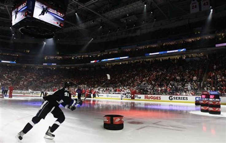 Team Lidstrom's Steven Stamkos, of the Tampa Bay Lightning (91) works in the fastest skater routine during the NHL All Star Skills Hockey competition on Saturday, Jan., 29, 2011, in Raleigh, N.C. (AP Photo/Gerry Broome)